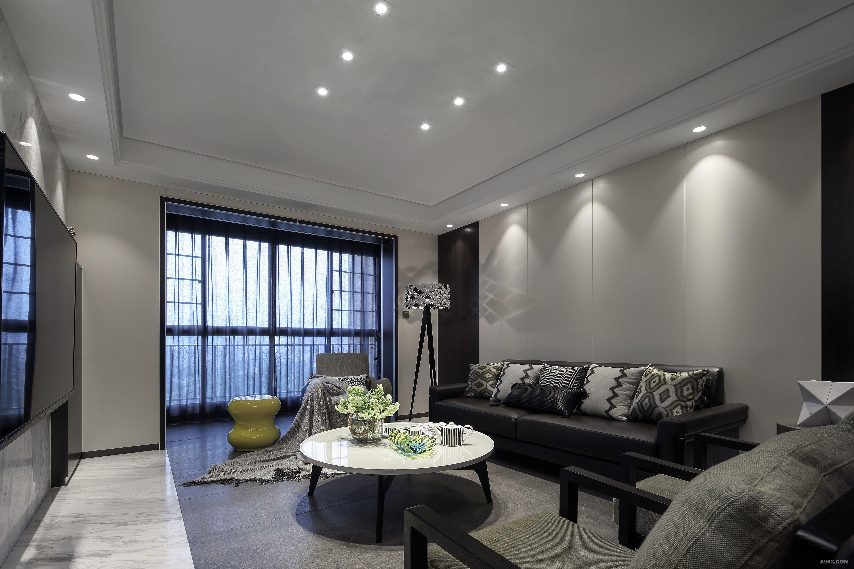 沙发后的背景墙选用了白色钢琴烤漆板和黑檀木饰面,落地灯的灯罩投影